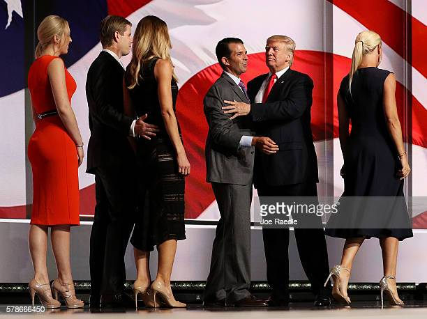 Republican presidential candidate Donald Trump and his son Donald Trump Jr. Embrace as Eric Trump, Lara Yunaska, Tiffany Trump and Vanessa Trump look...