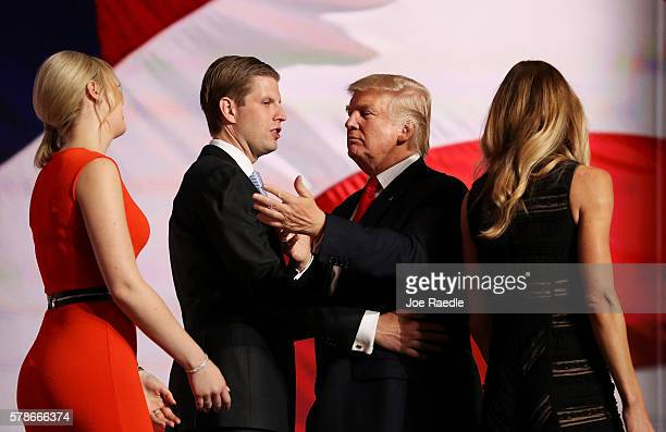 Republican presidential candidate Donald Trump and his son Eric Trump embrace as Tiffany Trump and Lara Yunaska walk by, on the fourth day of the...