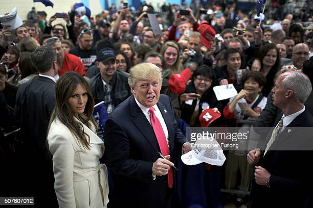 Republican presidential candidate Donald Trump and his wife Melania Trump sign autographs after a campaign rally at the Gerald W. Kirn Middle School...
