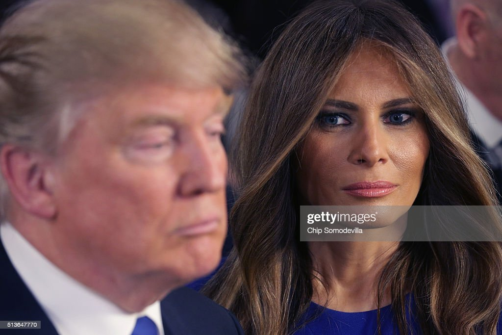 Republican presidential candidate Donald Trump and his wife Melania greet reporters in the spin room following a debate sponsored by Fox News at the Fox Theatre on March 3, 2016 in Detroit, Michigan. Voters in Michigan will go to the polls March 8 for the State's primary.