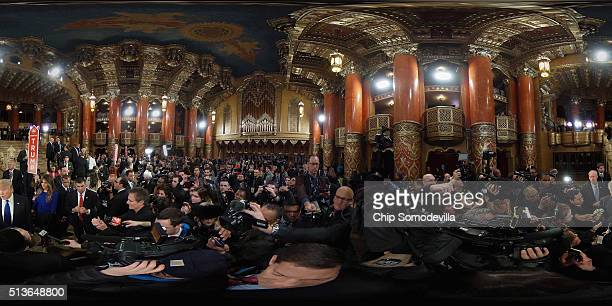 Republican presidential candidate Donald Trump and his wife Melania Trump talks to reporters in the ornate lobby of the historic Fox Theatre...