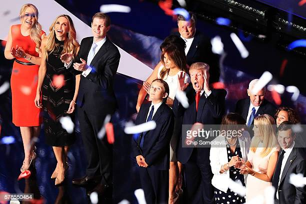 Republican presidential candidate Donald Trump and Republican vice presidential candidate Mike Pence stand with their families on the fourth day of...