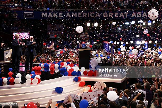 Republican presidential candidate Donald Trump and Republican vice presidential candidate Mike Pence acknowledge the crowd at the end of the...