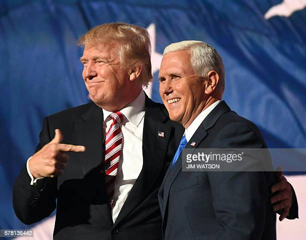 TOPSHOT Republican presidential candidate Donald Trump and vice presidential candidate Mike Pence at the end of the third day of the Republican...
