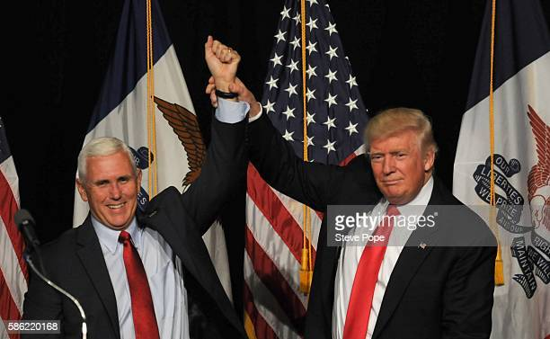 Republican Presidential Candidate Donald Trump and Vice Presidential candidate Indiana Governor Mike Pence greet supporters at a rally at the Iowa...
