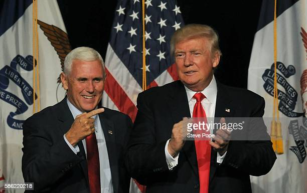 Republican Presidential Candidate Donald Trump and Vice Presidential candidate Indiana Governor Mike Pence greets supporters at a rally at the Iowa...