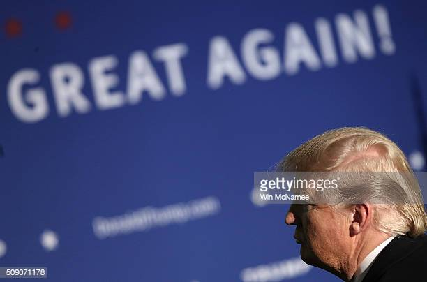 Republican presidential candidate Donald Trump answers questions during a town hall at the Lions Club February 8 2016 in Londonderry New Hampshire...