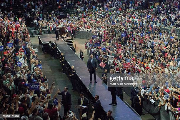 Republican presidential candidate Donald Trump applauds with the crowd at the end of a campaign rally at Xfinity Arena on August 30 2016 in Everett...