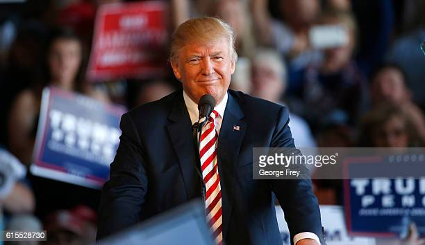 Republican presidential candidate Donald Trump approaches the podium to speak at a rally on October 18 2016 in Grand Junction Colorado Trump is on...