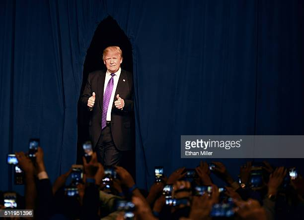 Republican presidential candidate Donald Trump arrives at a caucus night watch party at the Treasure Island Hotel Casino on February 23 2016 in Las...
