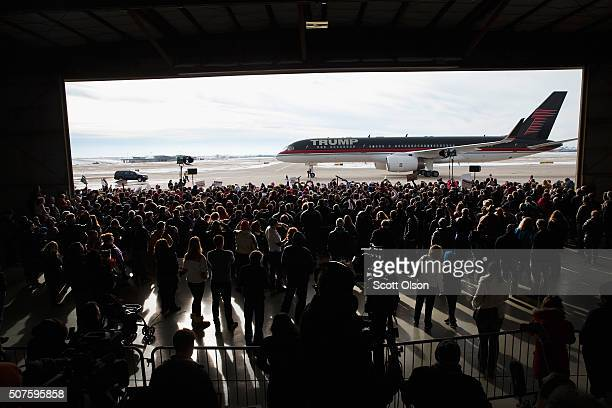 Republican presidential candidate Donald Trump arrives for a rally at the airport on January 30, 2016 in Dubuque, Iowa. Trump is in Iowa trying to...