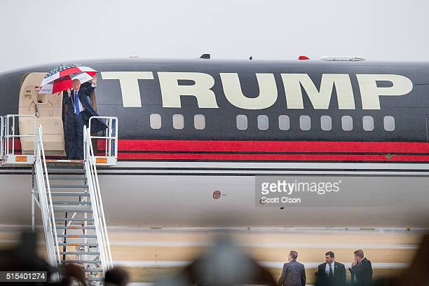 Republican presidential candidate Donald Trump arrives for a rally at the Central Illinois Regional Airport on March 13, 2016 in Bloomington,...