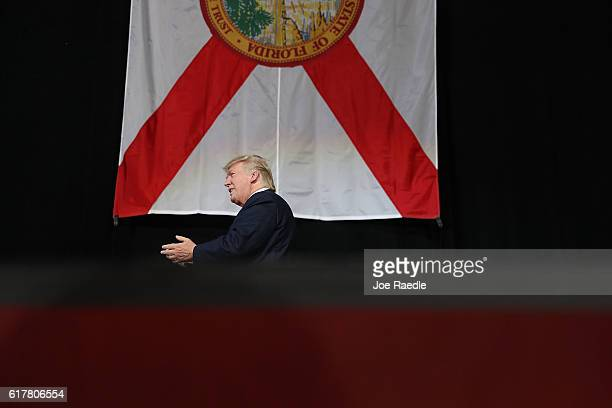 Republican presidential candidate Donald Trump arrives on stage to speak during a campaign rally at the MidFlorida Credit Union Amphitheatre on...