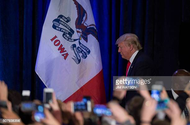 TOPSHOT Republican Presidential candidate Donald Trump arrives to address his supporters after finishing second in the Iowa Caucus in West Des Moines...