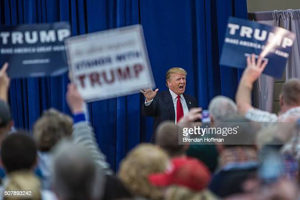 Republican presidential candidate Donald Trump arrives to speak at a campaign rally at the Ramada Waterloo Hotel and Convention Center on February 1...