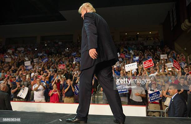 Republican presidential candidate Donald Trump arrives to speak to supporters at a rally at Erie Insurance Arena on August 12, 2016 in Erie,...
