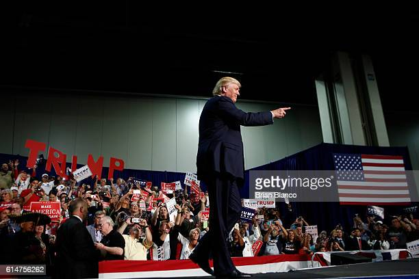 Republican presidential candidate Donald Trump arrives to speak to supporters at a rally on October 14 2016 at the Charlotte Convention Center in...
