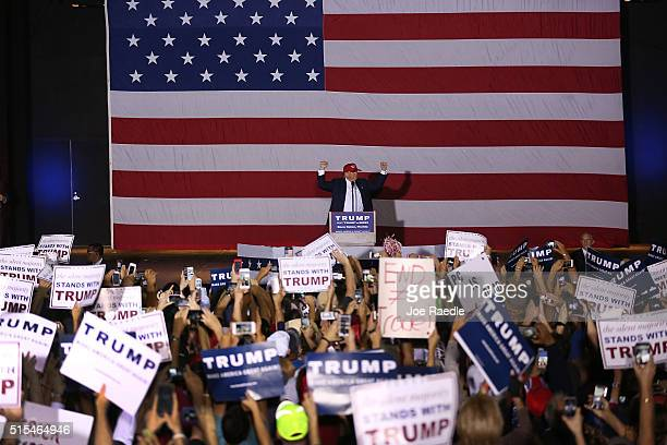 Republican presidential candidate Donald Trump attends his campaign rally at the Sunset Cove Amphitheater on March 13 2016 in Boca Raton Florida...