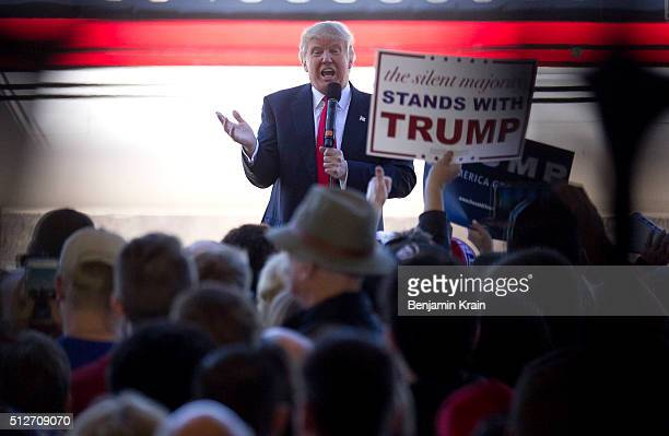 Republican Presidential candidate Donald Trump bashes Republican rival Marco Rubio as he talks to supporters at a campaign rally in an airplane...