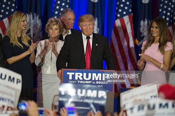 TOPSHOT Republican presidential candidate Donald Trump celebrates winning the South Carolina primary in Spartanburg South Carolina February 20 2016...