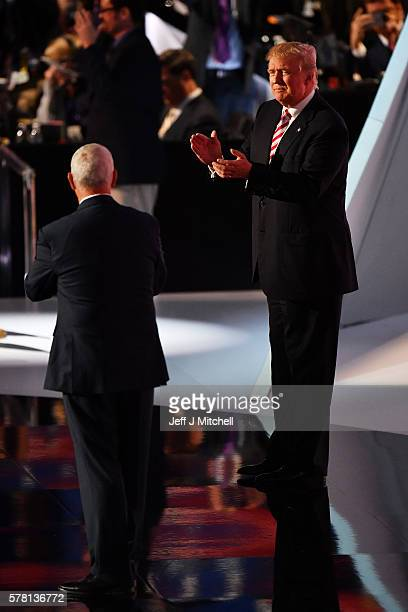 Republican presidential candidate Donald Trump claps after Republican vice presidential candidate Mike Pence delivered his speech on the third day of...