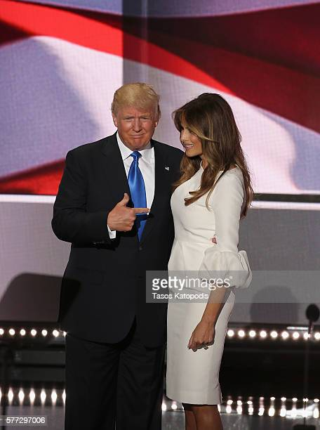 Republican presidential candidate Donald Trump claps as businesswoman and his wife Melania Trump speaks during the Republican National Convention at...