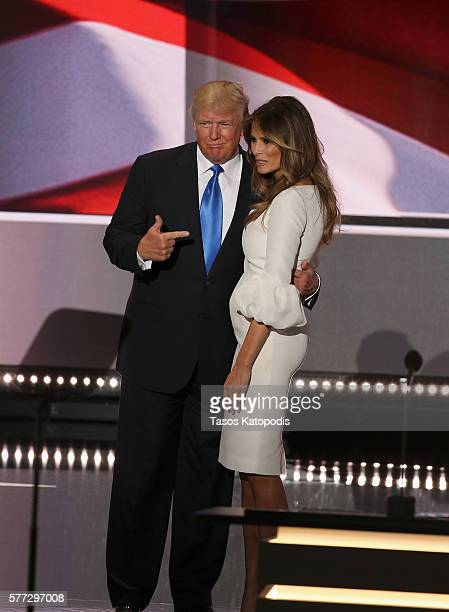 Republican presidential candidate Donald Trump claps as businesswoman, and his wife, Melania Trump speaks during the Republican National Convention...