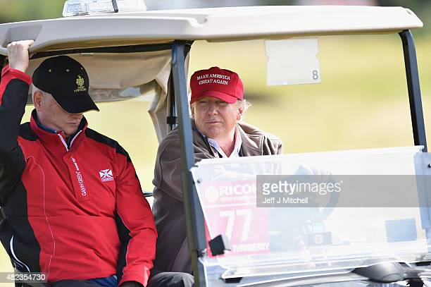 Republican Presidential Candidate Donald Trump drives a golf buggy during his visits to his Scottish golf course Turnberry on July 30 2015 in Ayr...