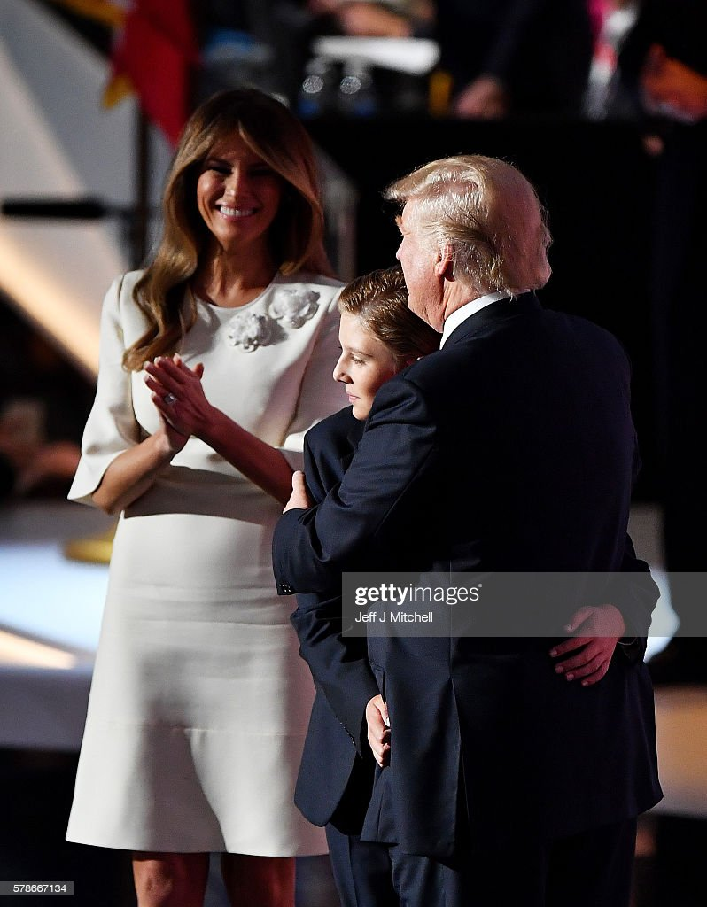 Republican presidential candidate Donald Trump (R) embraces his son Barron Trump, as his wife Melania Trump looks on at the end of the Republican National Convention on July 21, 2016 at the Quicken Loans Arena in Cleveland, Ohio. Republican presidential candidate Donald Trump received the number of votes needed to secure the party's nomination. An estimated 50,000 people are expected in Cleveland, including hundreds of protesters and members of the media. The four-day Republican National Convention kicked off on July 18.