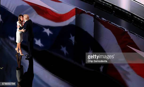 Republican presidential candidate Donald Trump embraces his wife Melania Trump at the end of the Republican National Convention on July 21 2016 at...