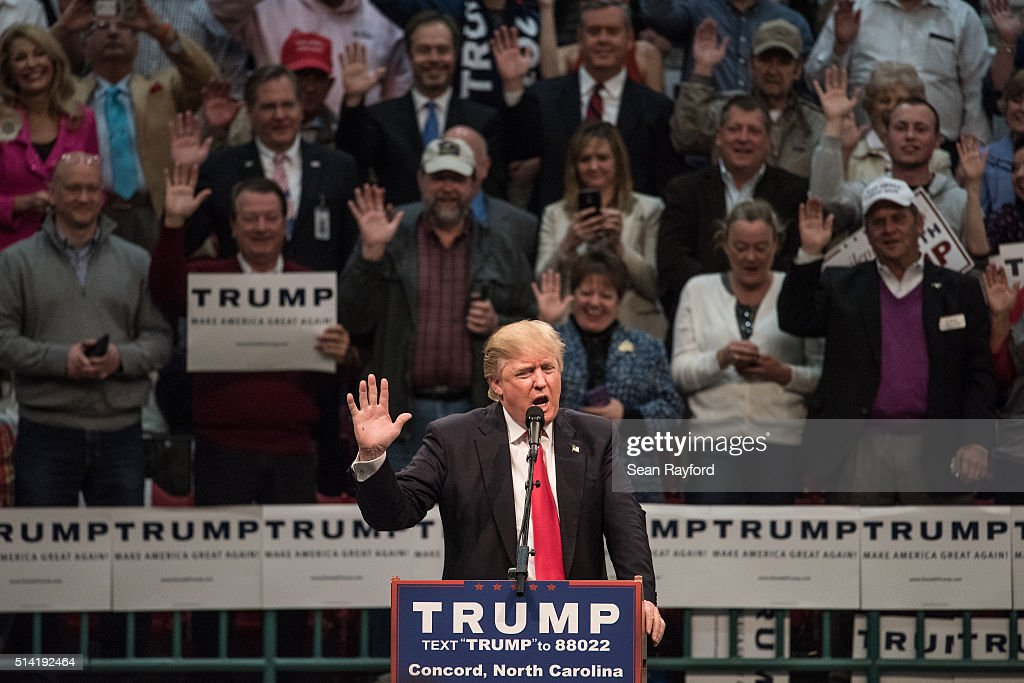 Republican presidential candidate Donald Trump encourages supporters to pledge their votes at a campaign rally March 7, 2016 in Concord, North Carolina. The North Carolina Republican presidential primary will be held March 15.