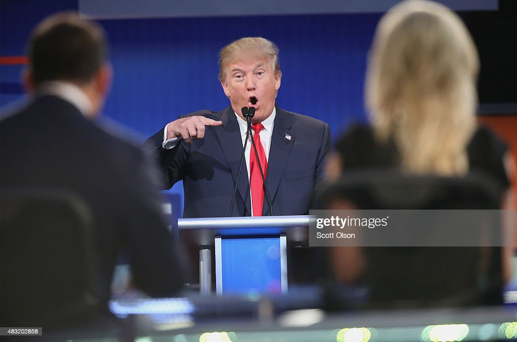 Republican presidential candidate Donald Trump fields a question during the first Republican presidential debate hosted by Fox News and Facebook at the Quicken Loans Arena on August 6, 2015 in Cleveland, Ohio. The top ten GOP candidates were selected to participate in the debate based on their rank in an average of the five most recent political polls.
