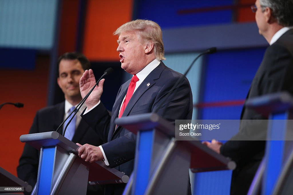 Republican presidential candidate Donald Trump (C) fields a question during the first Republican presidential debate hosted by Fox News and Facebook at the Quicken Loans Arena on August 6, 2015 in Cleveland, Ohio. The top ten GOP candidates were selected to participate in the debate based on their rank in an average of the five most recent political polls.