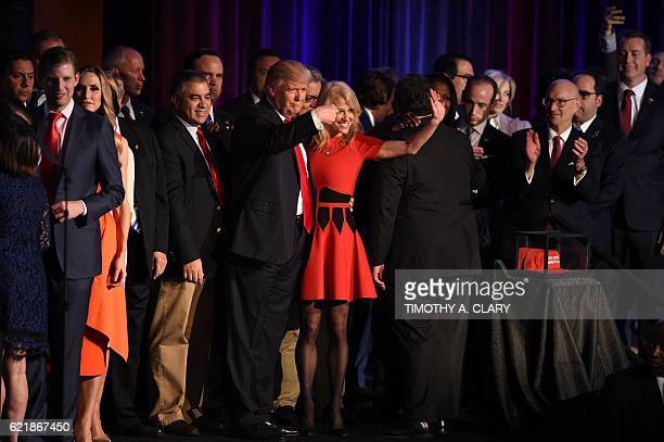 Republican presidential candidate Donald Trump flanked by campaign manager Kellyanne Conway waves to supporters following an address during election...