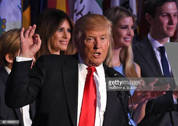 TOPSHOT Republican presidential candidate Donald Trump flanked by members of his family speaks to supporters during election night at the New York...