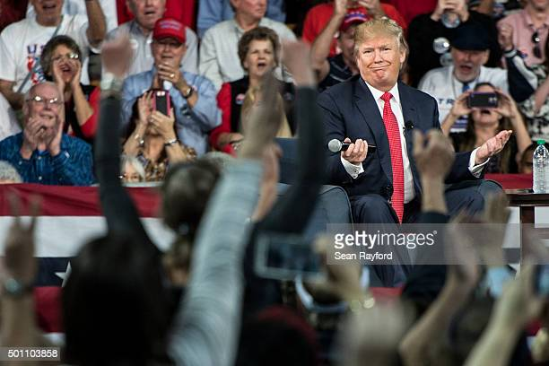 Republican presidential candidate Donald Trump gestures as he speaks to the crowd at a town hall meeting December 12 2015 in Aiken South Carolina The...