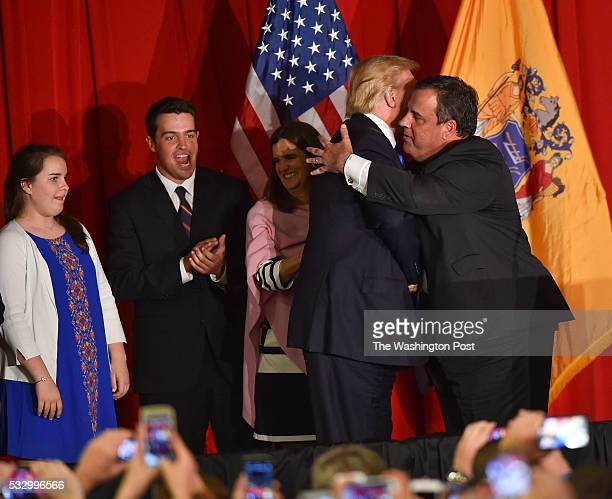 Republican presidential candidate Donald Trump gets a hug from supporter and New Jersey Governor Chris Christie before Trump addressed his supporters...
