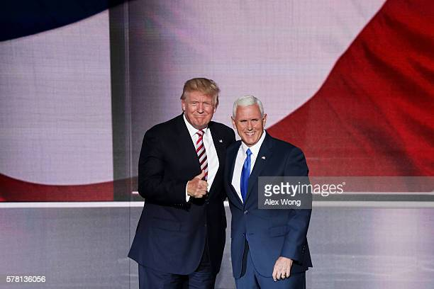 Republican presidential candidate Donald Trump gives a thumbs up with Republican vice presidential candidate Mike Pence on the third day of the...