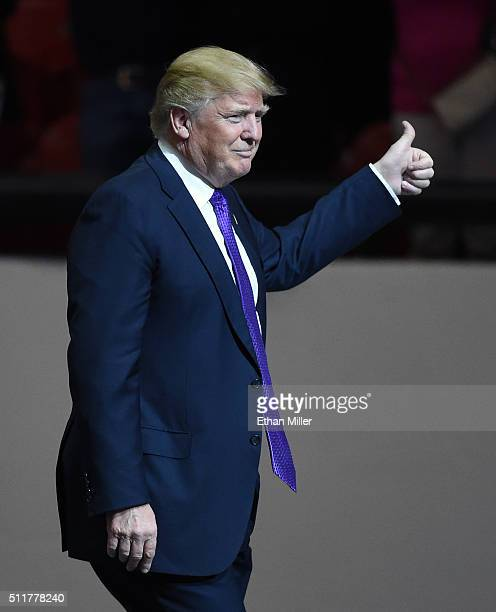 Republican presidential candidate Donald Trump gives a thumbsup as he arrives at a rally at the South Point Hotel Casino on February 22 2016 in Las...