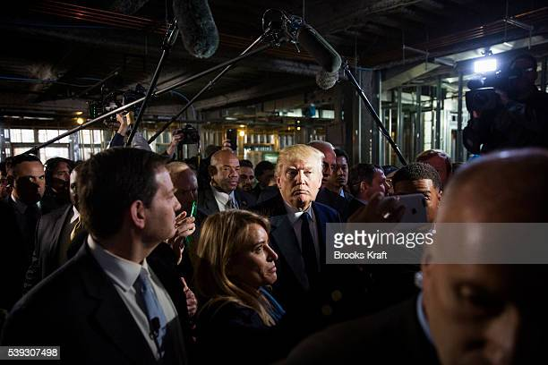 Republican presidential candidate Donald Trump gives the media a tour of the soon to be a Trump International Hotel March 21 2016 in Washington DC