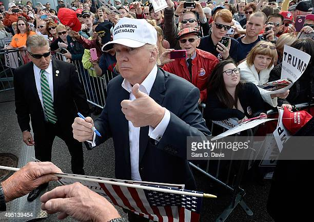 Republican presidential candidate Donald Trump gives the thumbsup to a US veteran after his rally in front of the USS Wisconsin on October 31 2015 in...