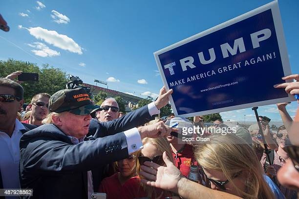 Republican presidential candidate Donald Trump greets fans tailgating outside Jack Trice Stadium before the start of the Iowa State University versus...