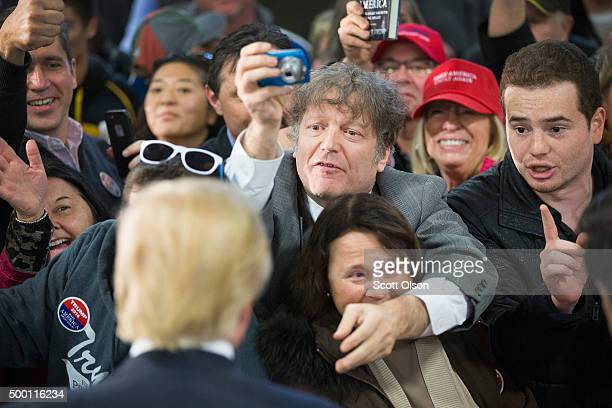 Republican presidential candidate Donald Trump greets guests at a campaign event at Mississippi Valley Fairgrounds on December 5, 2015 in Davenport,...