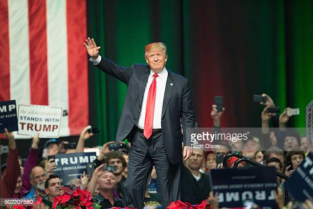 Republican presidential candidate Donald Trump greets guests at a campaign rally on December 21 2015 in Grand Rapids Michigan The fullhouse event was...