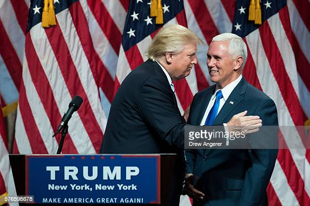 Republican presidential candidate Donald Trump greets his newly selected vice presidential running mate Mike Pence governor of Indiana as he takes...
