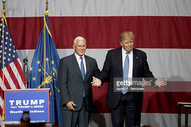 Republican presidential candidate Donald Trump greets Indiana Gov Mike Pence at the Grand Park Events Center on July 12 2016 in Westfield Indiana...