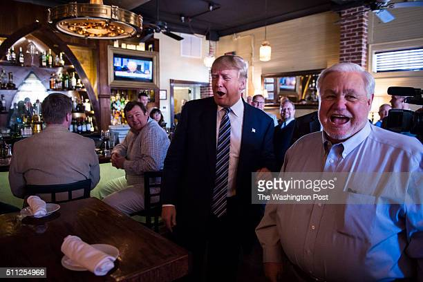 Republican presidential candidate Donald Trump greets North Charleston Mayor Keith Summey while making a stop for lunch between campaign events at...