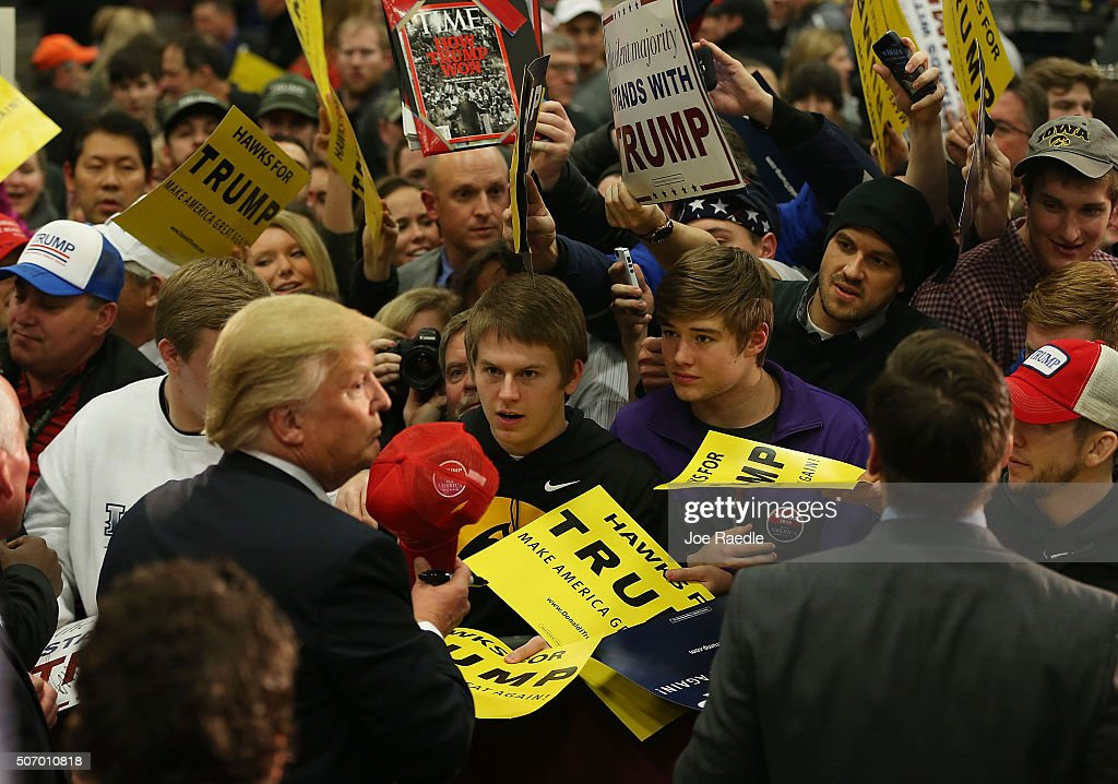 Republican presidential candidate Donald Trump greets people during a campaign event at the University of Iowa on January 26, 2016 in Iowa City, Iowa. Trump continues his quest to become the Republican presidential nominee.