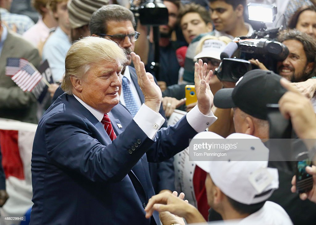 Republican presidential candidate Donald Trump greets supporters during a campaign rally at the American Airlines Center on September 14, 2015 in Dallas, Texas. More than 20,000 tickets had been distributed for the event.