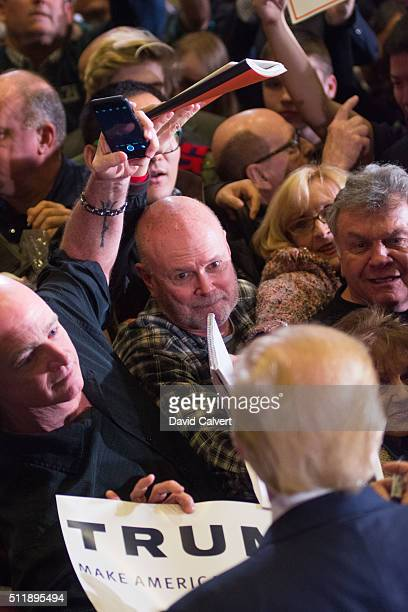 Republican presidential candidate Donald Trump greets supporters following a rally at the Nugget on February 23 2016 in Sparks Nevada The Nevada GOP...